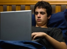 teen on laptop at bedtime