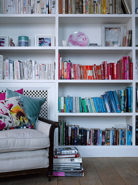 Fiona Douglas' color coded book case from DesignSponge