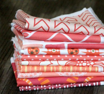 Coral fabric stack at Spoonflower
