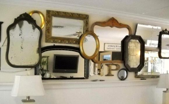 Here is a gallery wall I hung at my Mom's house made out of her mirror collection.