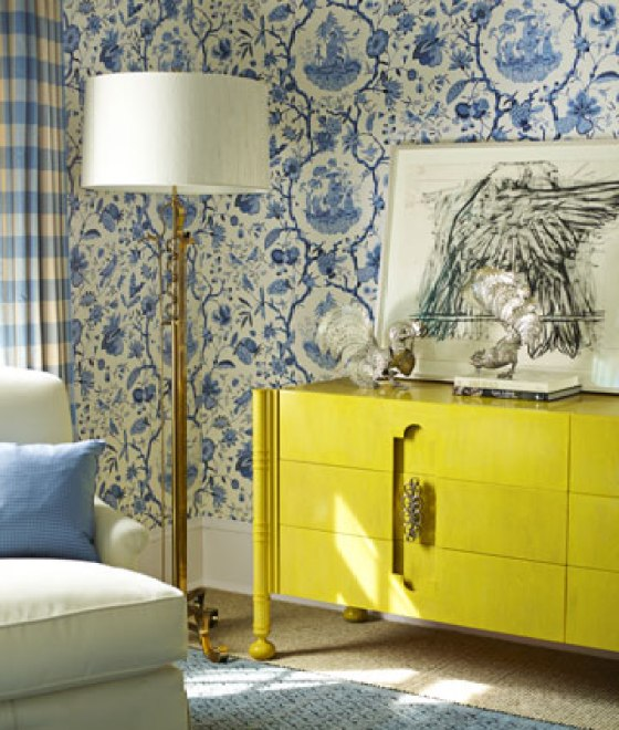 The mix of this very traditional wallpaper and this ultra modern dresser make for a great combinationPhoto via House