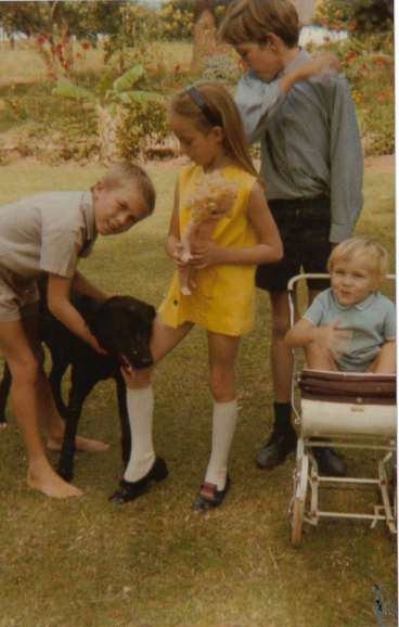 My brother Iain, me, my brother Andrew and our little sister Mairi, the 'baby' of the family, in our garden.