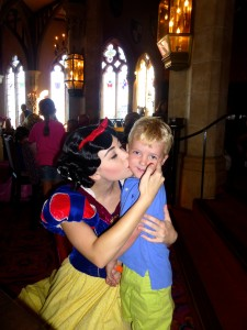 Snow White Kissing a little boy on the cheek