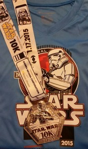 Inaugural runDisney Star Wars 10k finishers medal and tech shirt