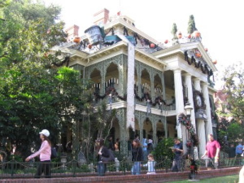 The Haunted Mansion decorated in jack-o-lanterns and garland