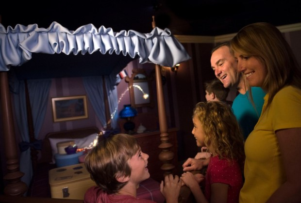 Family enjoying the new interactive cue at Peter Pan's Flight in Magic Kingdom