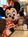 Minnie Mouse hugging a little girl