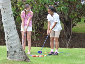 Isabella learning some putting skills.