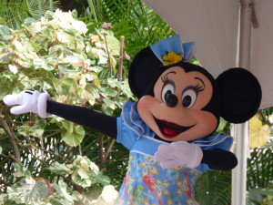 Minnie Mouse teaching the hula to the audience.