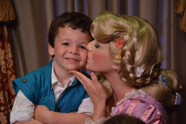 My tiny prince gets a kiss from his favorite Disney princess!