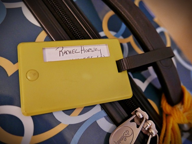 Luggage tag with only name showing through