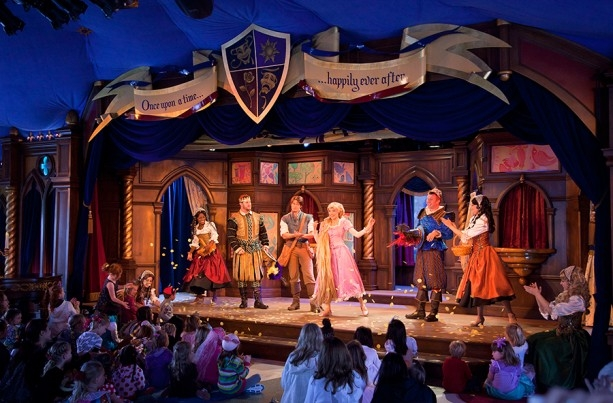 Image of the stage and actors from the Tangled show that plays at Disneyland Park at the Royal Theatre
