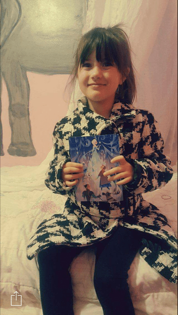Little Princess holding autographed Frozen postcard-Photo Credit Aimee Taylor