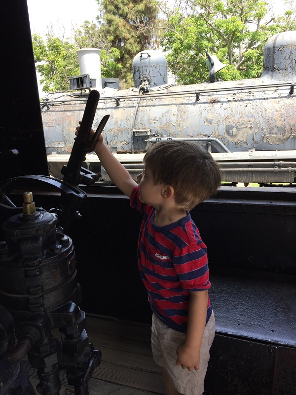 Pretending to be a Train Conductor at Travel Town