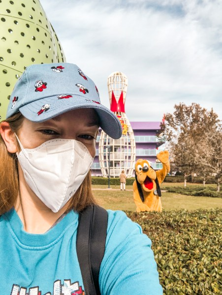 socially distant meet and greet with pluto at walt disney world resort hotel