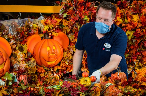Cast Member working on Magic Kingdom halloween decorations