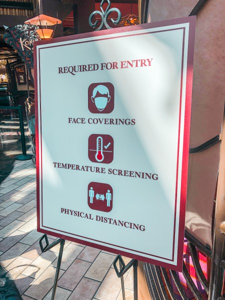 Health and safety notice outside dining locations in Walt Disney World