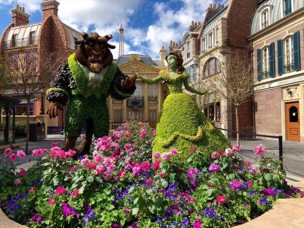 beauty and the beast topiary at 2021 epcot flower and garden festival