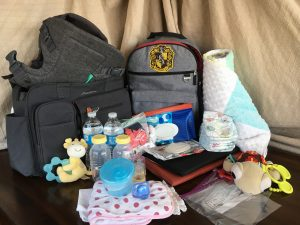 carry on backpack diaper bag baby packing travel vacation tsa security essentials organization