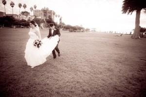 groom holding bride's dress