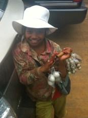 Khmer child sells quail eggs