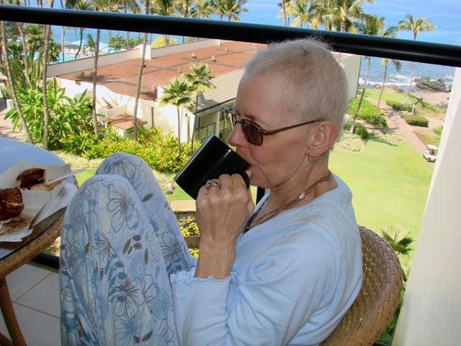 Cathy McDonald enjoying garden at Wailea Beach Resort, Maui. Photo by M. Maxine George