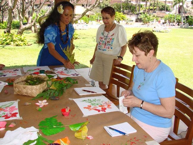 Malahini demonstrates flower painting at Ka'anapali Beach Resort, Maui, Hawaii