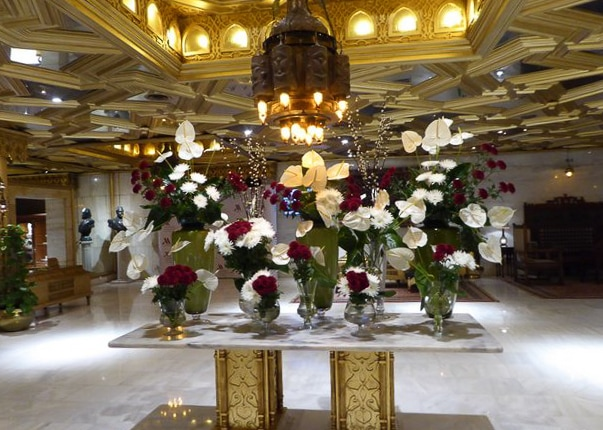 Floral display sits under the ornate ceiling in the lobby of Mena House