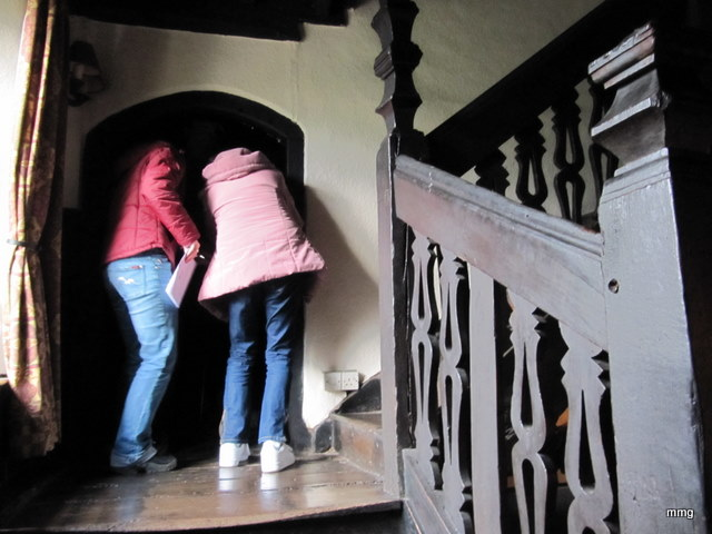 Canadian gals stop on the landing to peer into the small room used to incarcerate prisoners at the Skirrid Mountain Inn, Wales. Photo by M. Maxine George