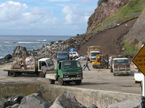 Trucks on wharf, Norfolk Island. Picture courtesy of Barry and Heather Minton