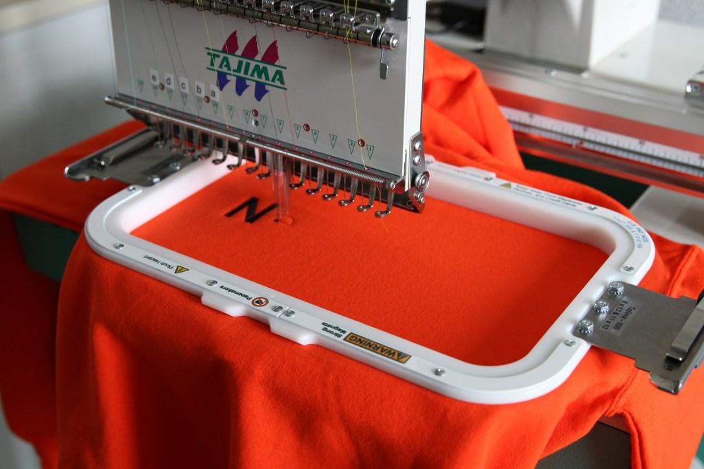 embroidery machine with orange hoodie