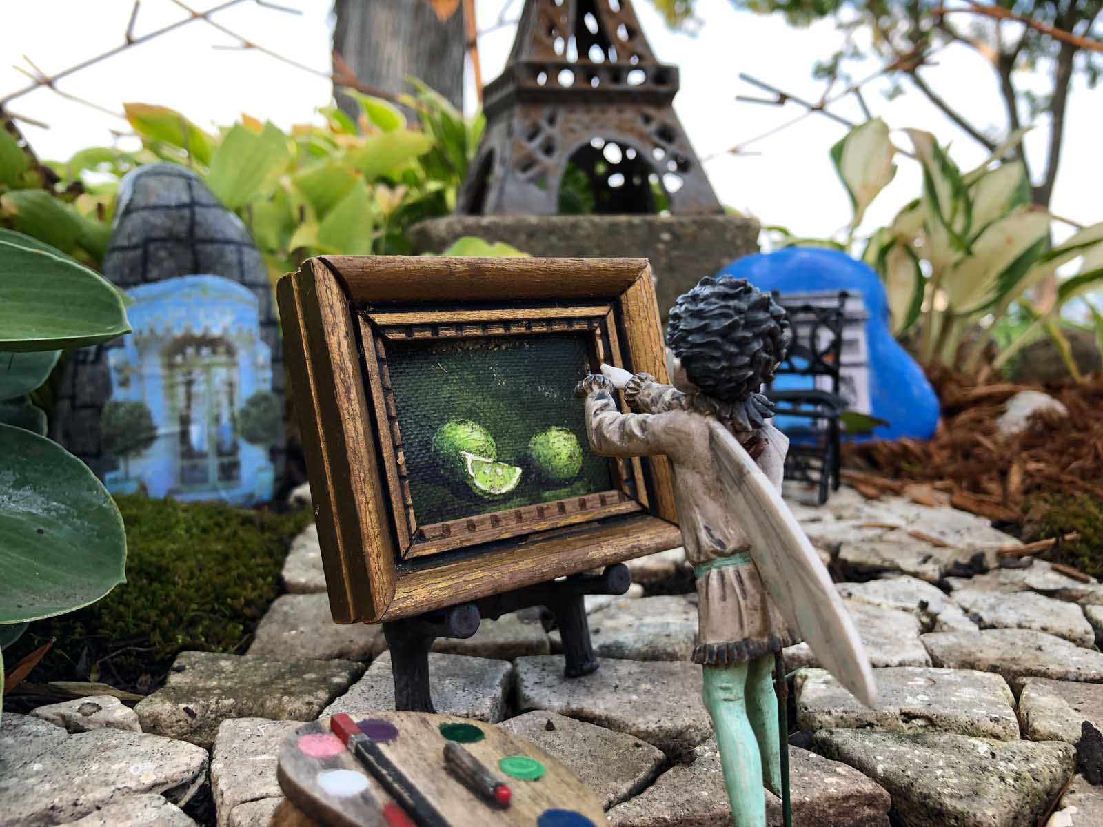 Finished Magic Gardens with fairy painting in Paris with stone path Eiffel Tower and Landmark Rocks
