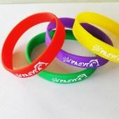 """Резиновые браслеты с логотипом """"Раудуга"""". Логотип отпечатан шелкографией белой краской"""