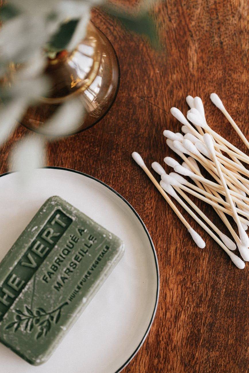wooden table with soap and ear sticks