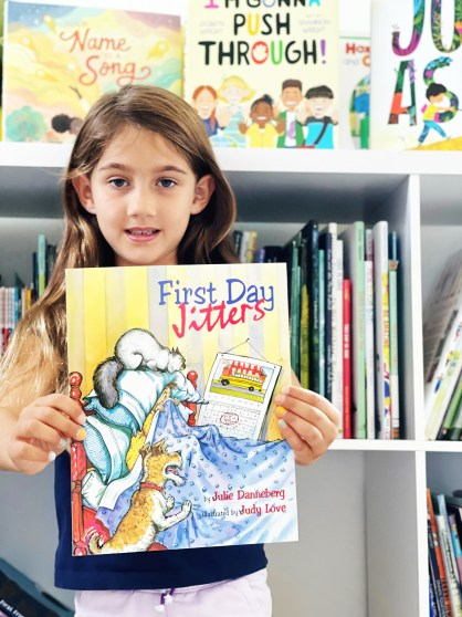 Student holding back to school book First Day Jitters