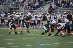 Zach Zubia '15 and Dwyer Bucey '15 prepare for the snap against the Rangers' defensive line. Photo : MAGIS