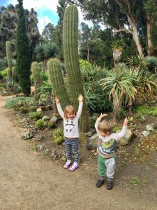 Kids posing with cacti