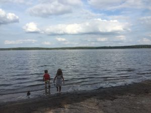 Kids wading in the lake