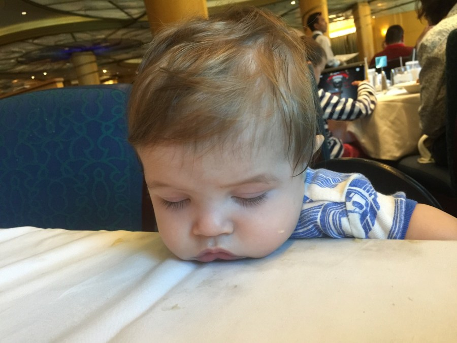 K sleeping at the table