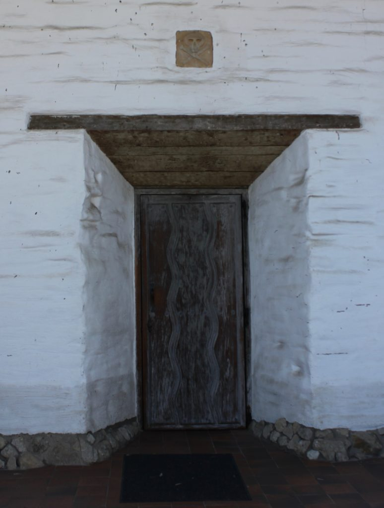 Door from graveyard to church