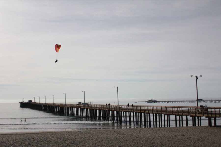 Paraglider over pier