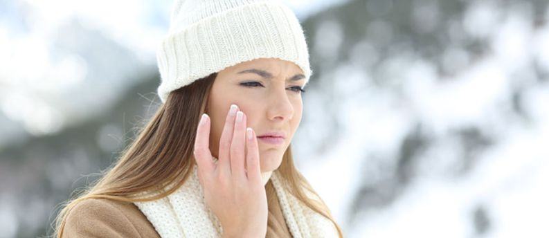 Angry woman using a sking protection cream in winter