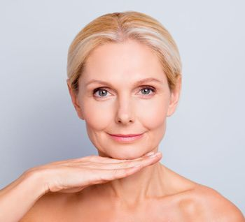 mature woman with smooth skin from regular botox treatments