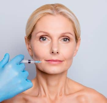 tired looking woman receiving Juvederm treatments