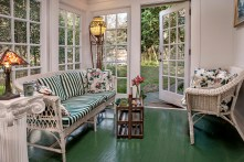 The sunroom at Miss Huey's Cottage remains bright & airy to cheer any mood.