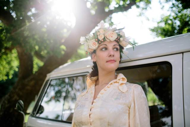 1970s vintage wedding boho bride with camper van and flower crown photo by Binky Nixon for the National Vintage Wedding Fair