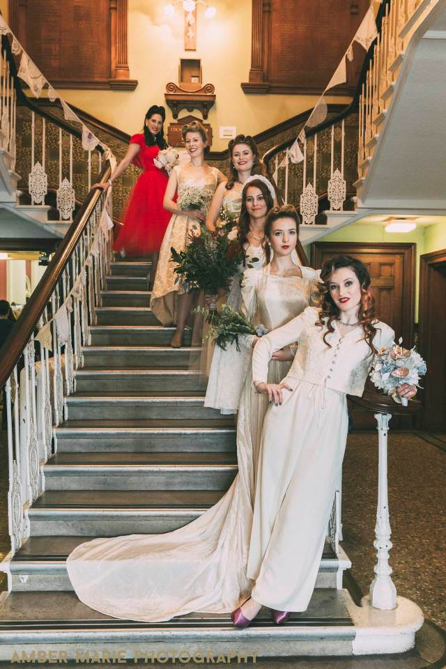 Vintage wedding dresses at the fashion parade photo by Amber Marie Photography at the National Vintage Wedding Fair