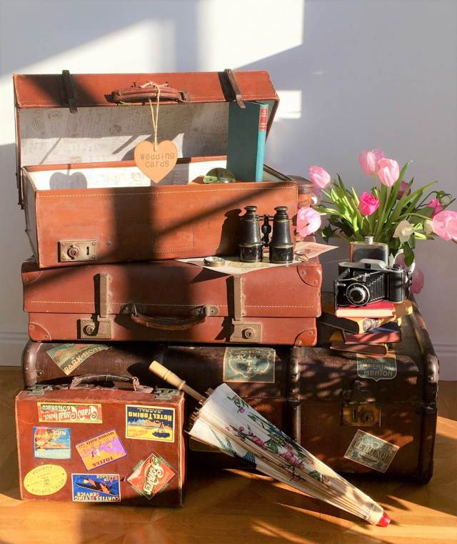 Styling ideas for a vintage wedding using suitcases for a card table