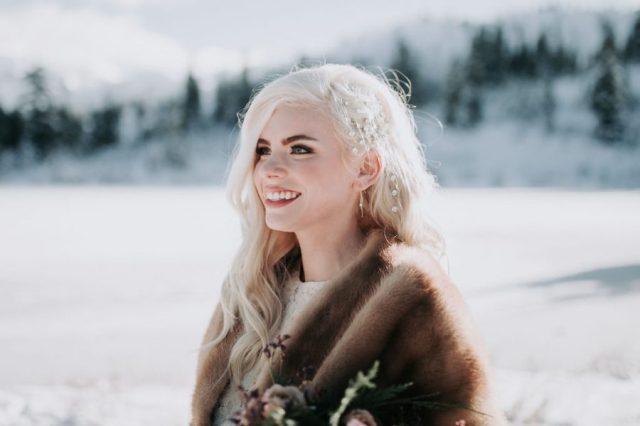 Winter Wonderland Wedding with Blue Wedding Dress and Fur Capelet