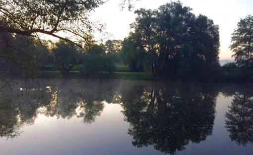 Sunrise on the Kolpa River at Big Berry Lifestyle Camp in Primostek, Slovenia